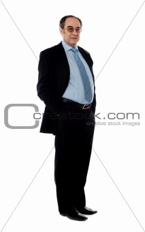Full length portrait of senior company director