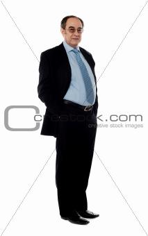 Full length portrait of senior company director