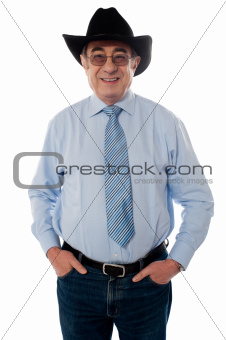 Portrait of a senior cowboy wearing hat