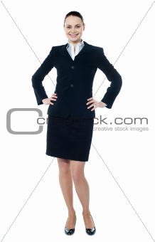 Female executive posing with hands on her waist