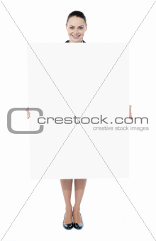Young woman holding blank billboard