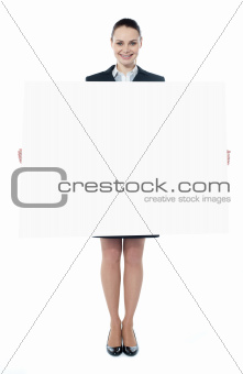 Confident young executive with an advertising board