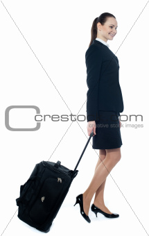 American tourist dragging her trolley bag