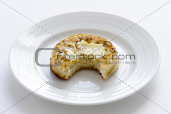crumpet with bite taken
