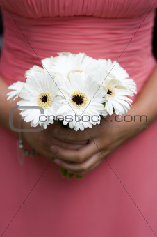 bridesmaid holding a bouquet of berbera