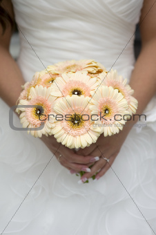 bride holding gerbera bouquet
