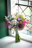 wedding bouquet near a window