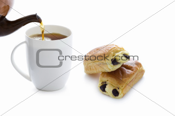 pouring tea with pain au chocolat