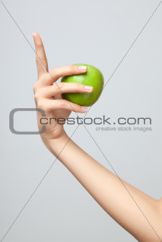 Hand holding apple.