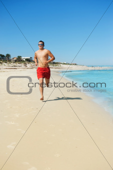 man running along the coast