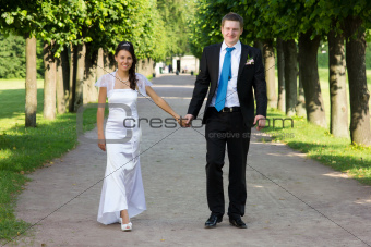 Happy young couple go to alley