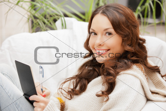 happy woman with small notepad