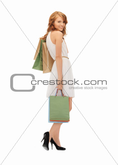 happy teenage girl with shopping bags