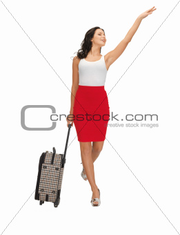 hitch-hiking woman with suitcase