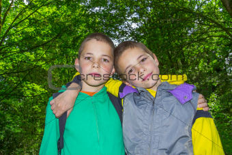 Portrait of two hugging boys, tweens