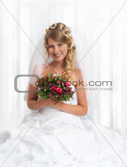 Portrait of young beautiful smiling bride