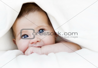 baby under blanket