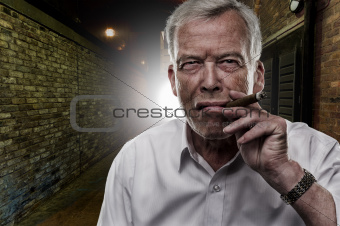 Senior man smoking a cigar