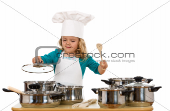 Child playing with cooking bowls
