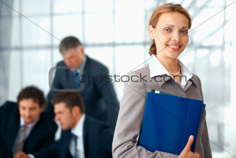 Business Woman With Blue Folder.