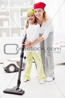 Little girl learning chores