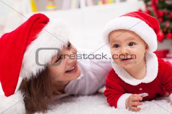 Our first Christmas - mother and baby with santa hats