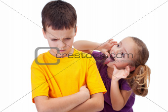 Young girl mocking boy - isolated