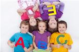 Group of kids holding alphabetical letters