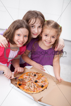 Three girlfriends sharing a pizza
