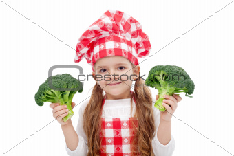 Happy little chef girl with broccoli