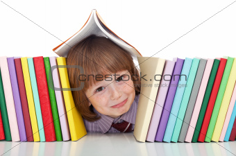 Mischievous kid with freckles and books