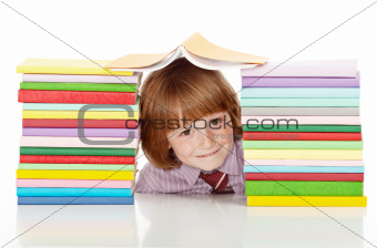 School boy with lots of colorful books