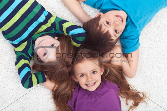 Kids laying on the floor together