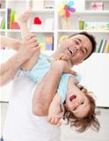 Father playing with toddler son