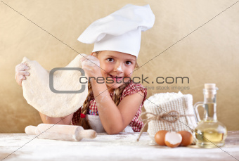 Little girl making pizza or pasta dough