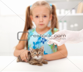 Little girl afraid for her kitten getting a vaccine at the veter