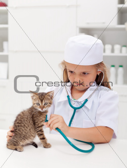 Little girl playing at the vet