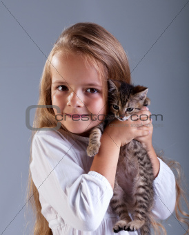 Adorable little girl and her kitten