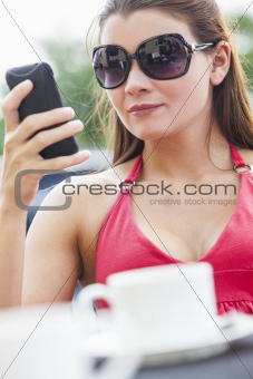 Beautiful Young Woman Cell Phone Texting in Cafe