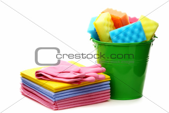 Cleaning cloths and bucket with colored sponges.