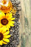 Seeds, sunflower oil and flowers