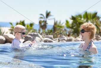 mother and son splashing