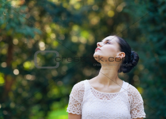Portrait of thoughtful girl in woods looking on