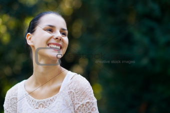 Portrait of smiling girl in woods looking on