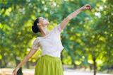 Young woman dancing in park