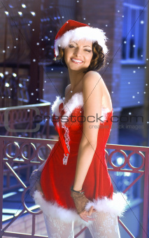 beautiful girl wearing santa claus clothes