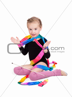 adorable girl gymnast isolated on a white