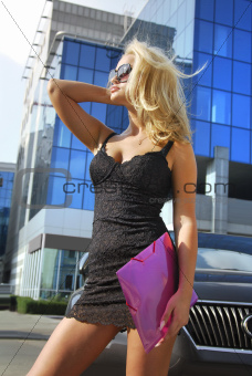 blonde businesswoman with violet folder