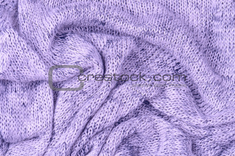 close up purple knitted pullover background