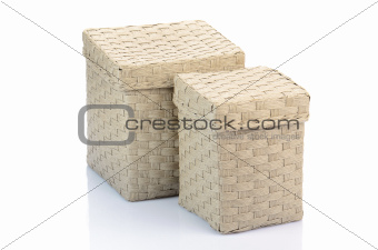 gray wicker boxes isolated on white